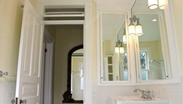 Totally DIY! Vintage-inspired bathroom remodel. We used subway tile, marble lookalike and designed a custom medicine cabinet.