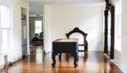 victorian kitchen with repurposed grand piano island